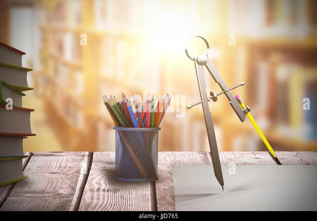 Digitally generated image of drawing compass with pencil against aisle along bookshelves in college library - Stock Image