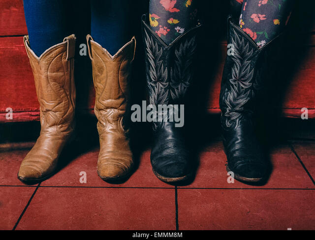 Cowgirls in cowboys boots. - Stock Image