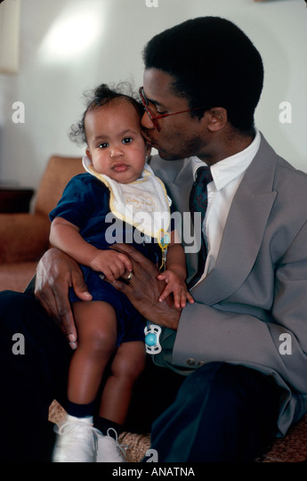 New Jersey Teaneck Black father kisses daughter baby family bonding - Stock Image