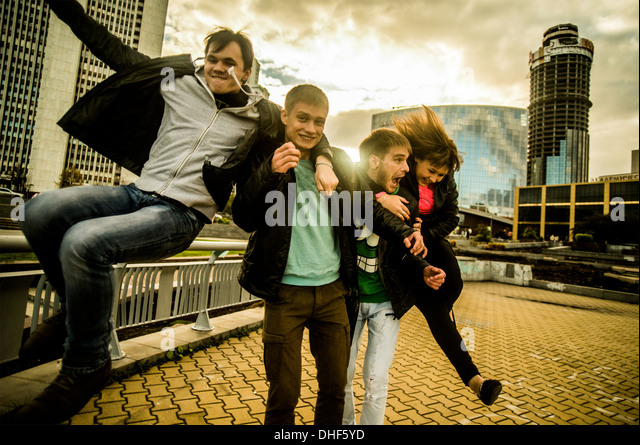 Four friends having fun in urban scnee, Russia - Stock Image