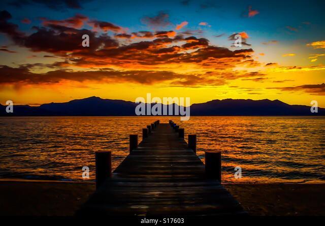 Sunset on pier on Lake Tahoe at Nevada Beach, Nevada - Stock-Bilder