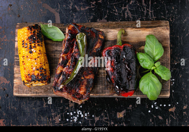 BBQ meat and vegetables - Stock Image