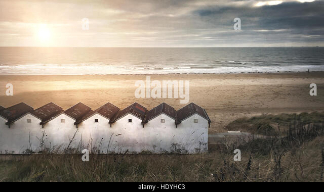 calming image of beach cabins by the sea - Stock Image