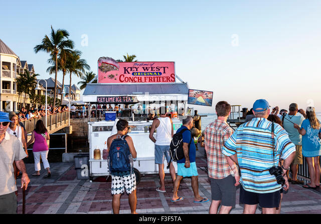 Key West Florida Keys Mallory Square Dock sunset celebration festival food vendor conch fritters sale - Stock Image