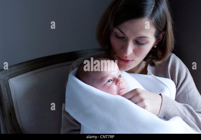 Woman holding newborn baby - Stock Image