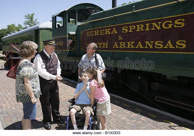 Arkansas Eureka Springs Eureka Springs and North Arkansas Railway conductor man girl boy disabled wheelchair woman - Stock Image
