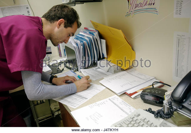 Miami Beach Florida Mt. Mount Sinai Medical Center hospital doctor's office EKG technician medical records career - Stock Image