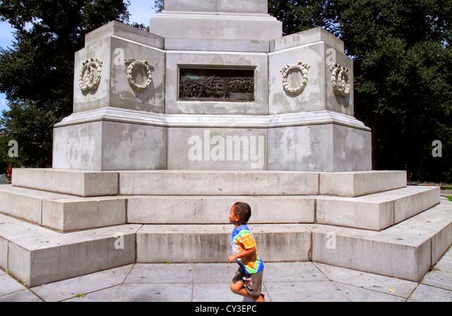 Boston Massachusetts Boston Common public park Soldiers and & Sailors Monument memorial Hispanic boy running - Stock Image