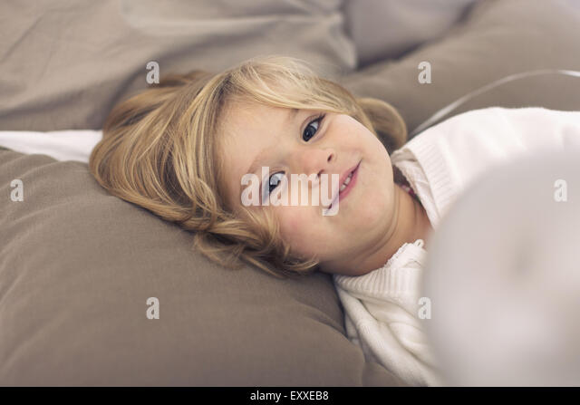 Little girl relaxing at home - Stock Image