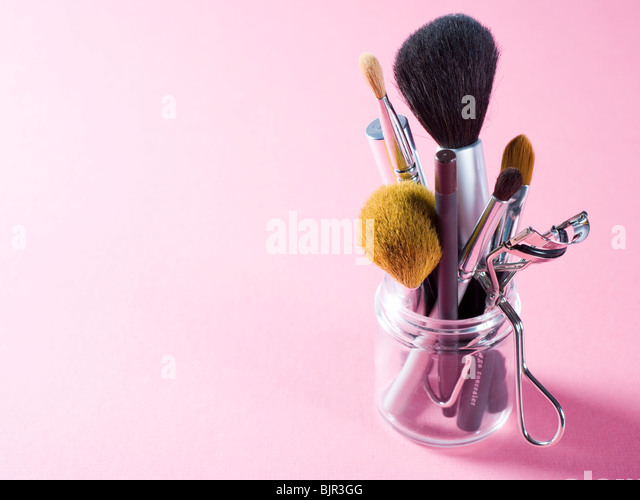 Assorted makeup brushes and cosmetics instruments. - Stock Image