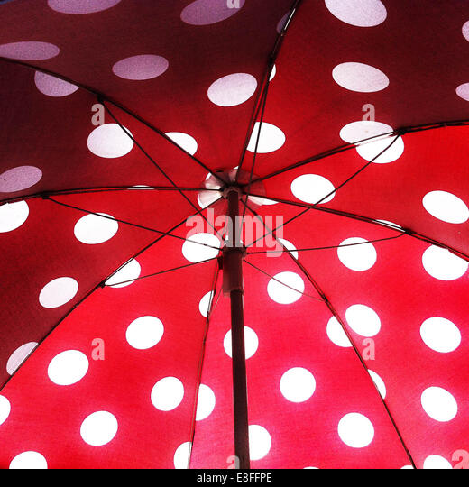 Open umbrella with polka dot pattern - Stock Image