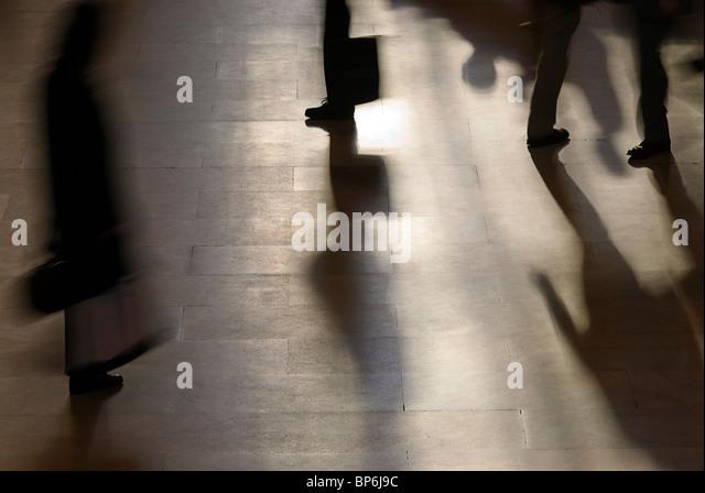 People Rush through Station - Stock Image