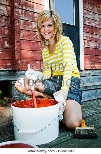 Girl stiring paint - Stock-Bilder