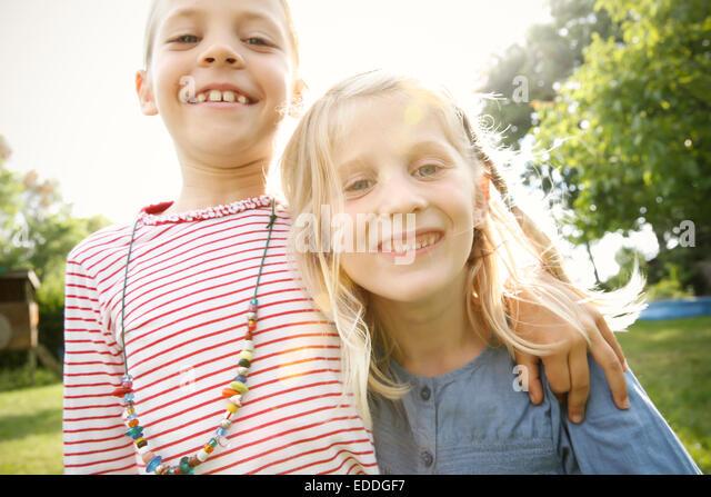 Two happy little girls - Stock-Bilder