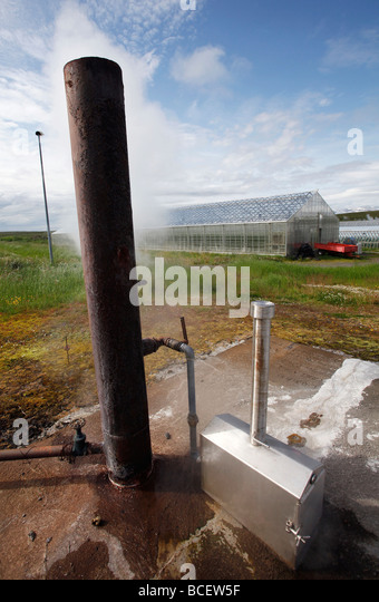 A borehole supplies geothermal heat to greenhouses, Iceland - Stock Image