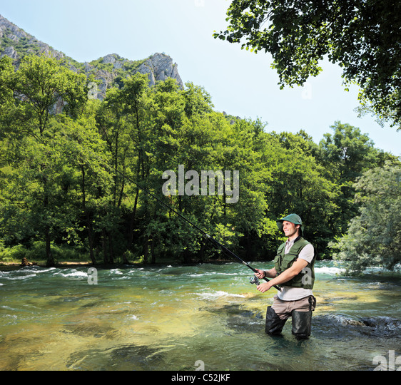 Young fisherman fishing on a river Treska, Macedonia - Stock-Bilder