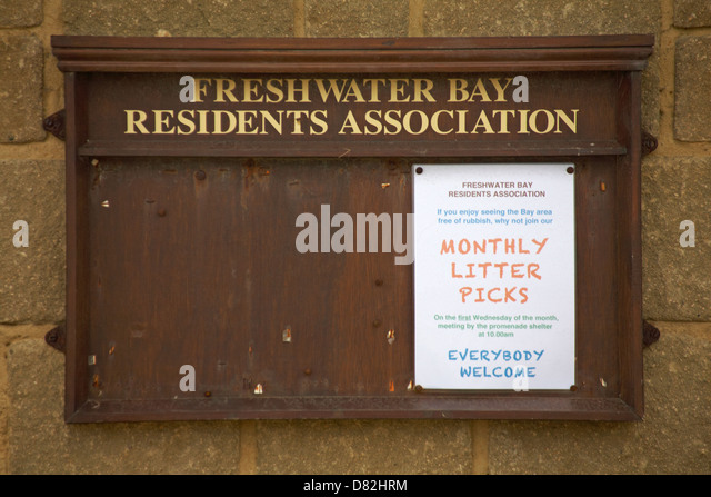 Monthly litter picks notice on Freshwater Bay Residents Association notice board at Freshwater Bay, Isle of Wight - Stock Image