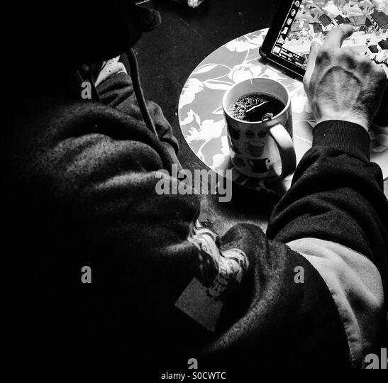 Morning coffee together with a game - Stock Image