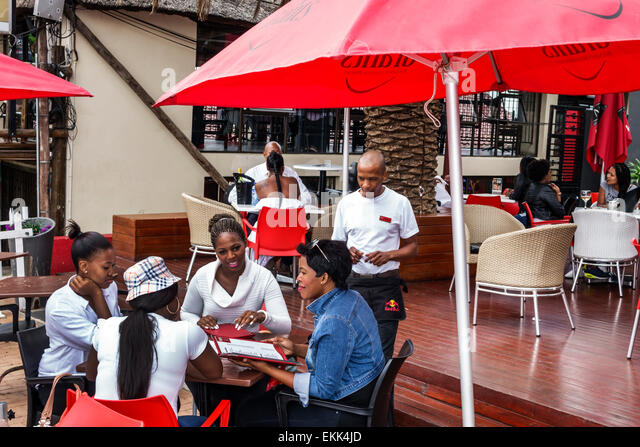South Africa African Johannesburg Soweto Vilakazi Street Precinct Sakhumzi restaurant table alfresco dining Black - Stock Image