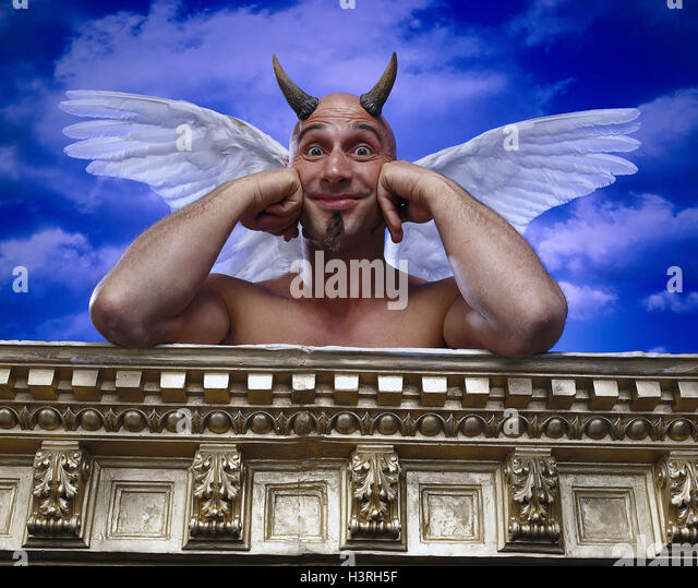 Devils, angel's wings wing, rest on, cunning, sanctimony, cloudy sky, studio, - Stock Image