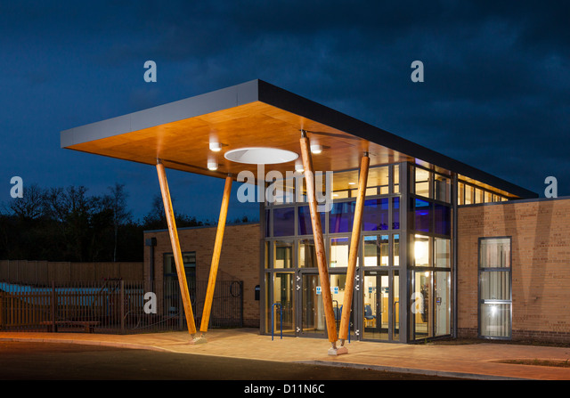 the modern architecture canopy forming the main entrance to Mountjoy School, Beaminister at dusk - Stock Image