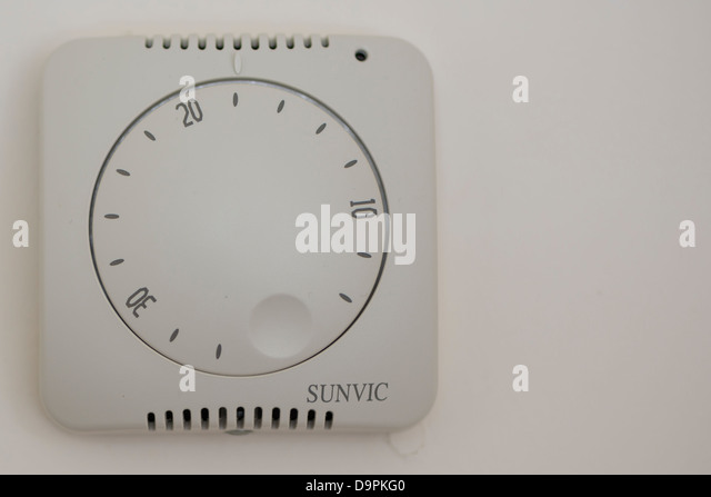 A wall tthermostat set at 18 degrees centigrade - Stock Image