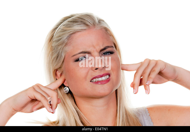 Young woman suffers from noise pollution, keeps closed to herself the ears., Junge Frau leidet unter Laermbelaestigung, - Stock Image