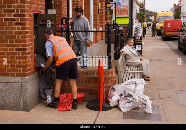 Postman Emptying Postbox At Post Office In Aldeburgh,Suffolk,Uk - Stock Image