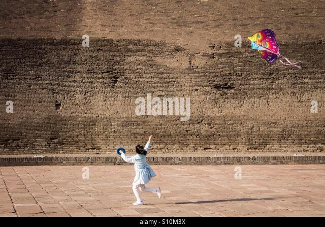 Girl with kite - Stock-Bilder
