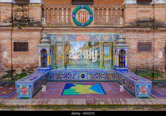 Glazed tiles bench of spanish province of Valencia at Plaza de Espana, Seville, Spain - Stock Image