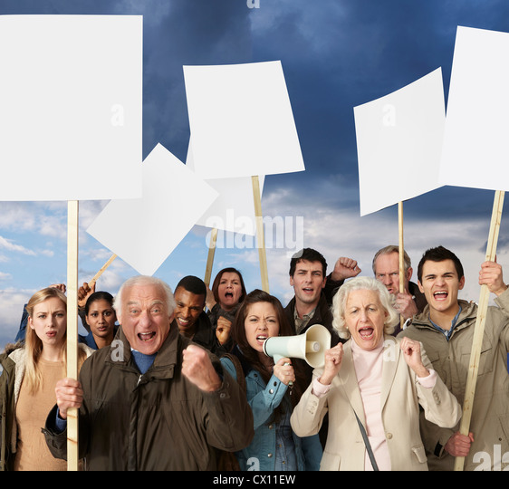 Group of angry protesters holding blank banners - Stock Image