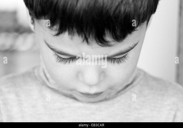 Close-up portrait of a boy looking down - Stock-Bilder
