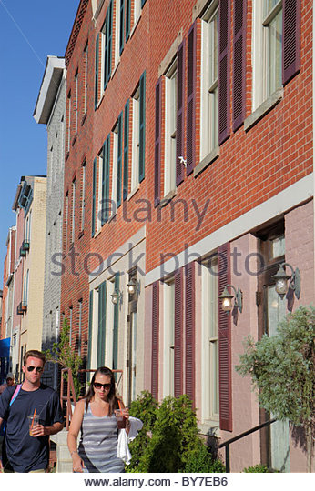 Maryland Baltimore Little Italy ethnic neighborhood working class community row house townhouse man woman couple - Stock Image