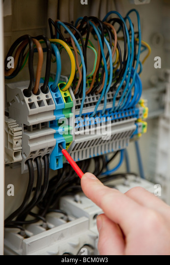 Electrician at work - Stock Image