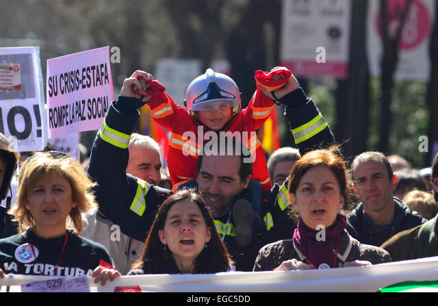 A young boy dressed with firefighter clothes during a demonstration defending public services in Madrid. 22nd, Feb. - Stock Image