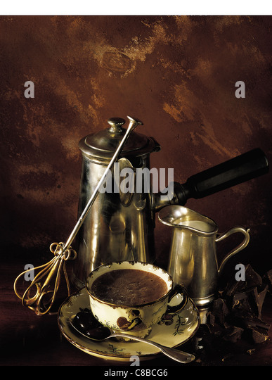 hot chocolate pot and cup of hot chocolate - Stock Image