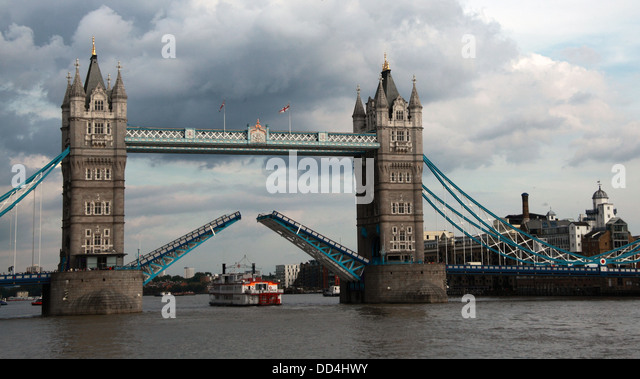 Historic Tower Bridge opens on the Thames, London, England, UK - Stock Image