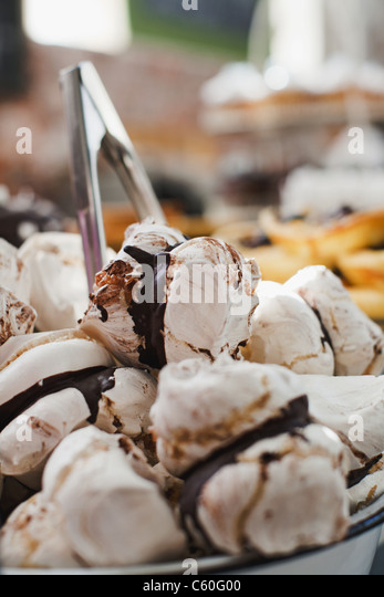 Close up of decorative cookies in bakery - Stock Image