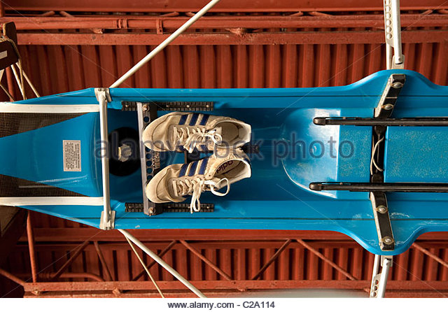 Rowing shoes sit strapped into the scull - Stock Image