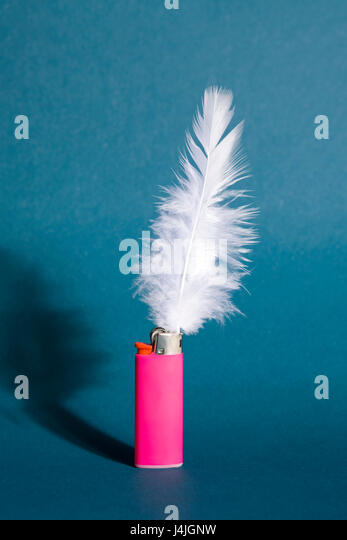 A feather in place of a flame on a lighter - Stock Image
