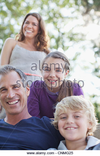 Family relaxing together outdoors - Stock-Bilder
