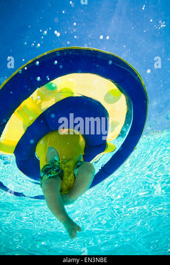 baby in a swimming pool - Stock Image