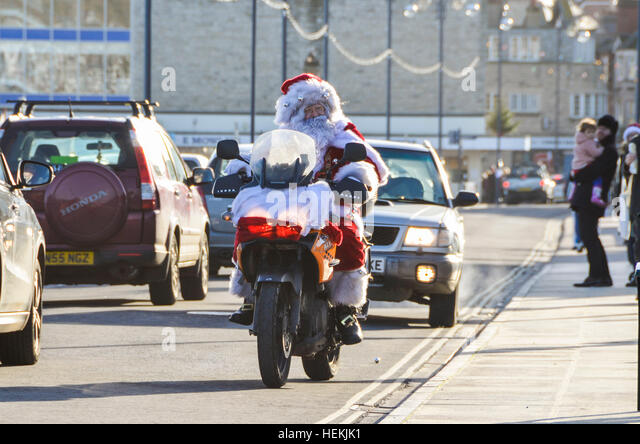 Swanage, Dorset, UK.  22nd December 2016.  A motorbiking Father Christmas visits Swanage on his tour of Dorset. - Stock Image