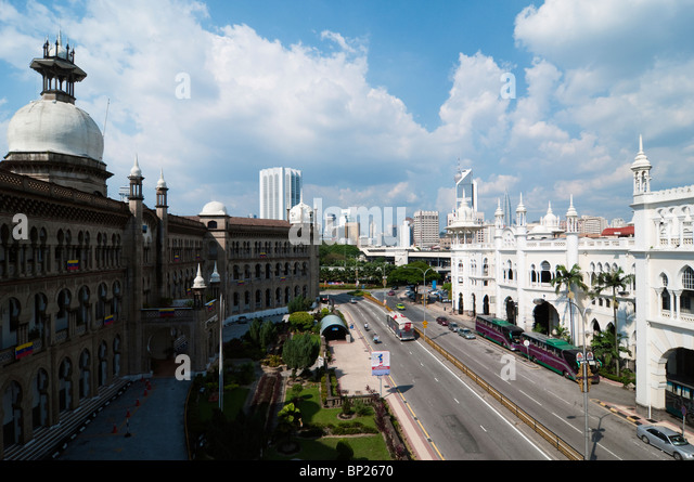 Malayan Railway Administration Building and the Old KL Train Station split by Jalan Sultan Hishamuddin in Kuala - Stock Image
