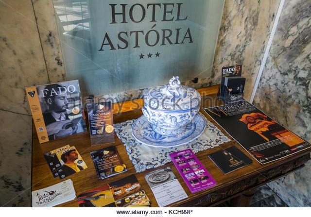 Coimbra Portugal historic center Astoria Hotel 1926 landmark Parisian Art Nouveau table brochures guest information - Stock Image