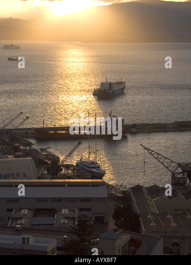 Sunset over The Bay of Gibraltar Shipyard, cloud, freight, ship, shipping, tanker, boat, shipyard, Gibraltarian, - Stock Image