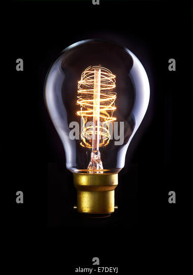 A classic Edison bulb with a loop filament. Switched On. - Stock Image