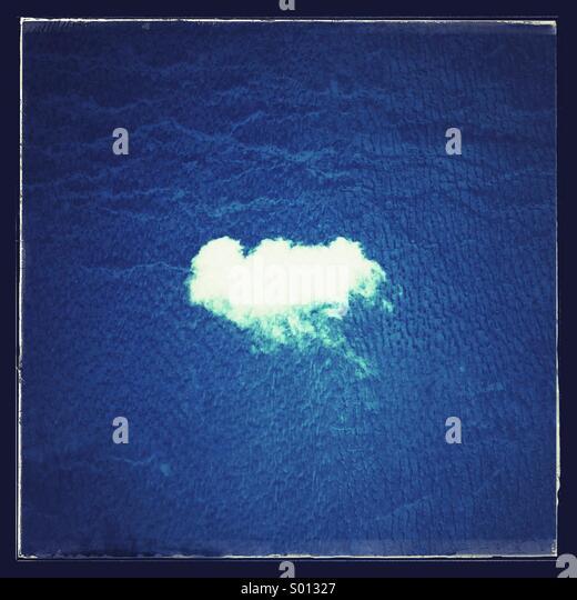 Single white puffy cloud - Stock Image