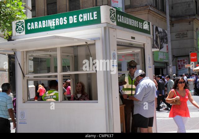 Chile Santiago Paseo Ahumada street scene Carabiniers Carabineros de Chile national police law enforcement public - Stock Image