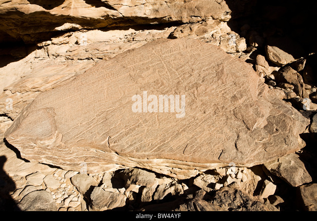 Etchings on a fallen rock in the Eastern Desert of Egypt - Stock Image
